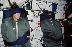 astronauts-sleeping-in-space-strapped-down-to-wall