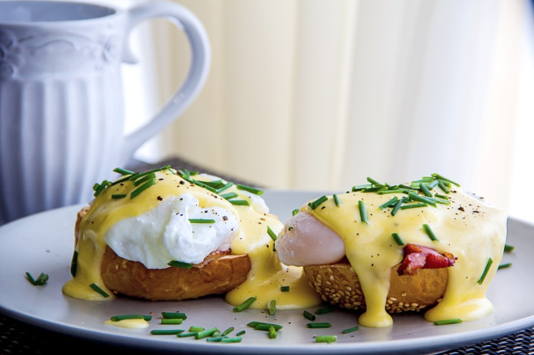 Eggs Benedict- toasted muffins, ham, poached eggs, and delicious buttery hollandaise sauce