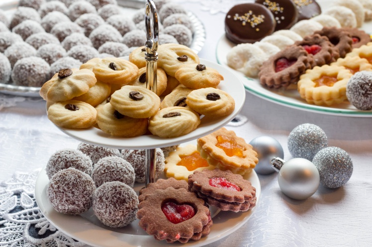 Variations of sweet cookies on a table.